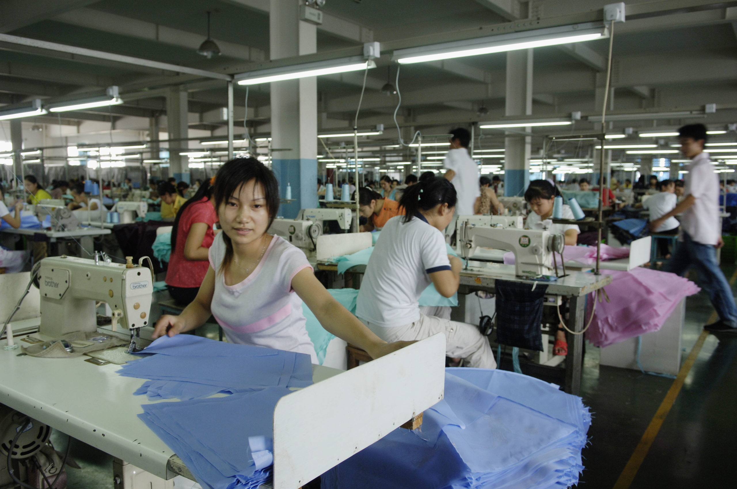 Seamstresses at Paradise Umbrella Group CO., the largest umbrella manufacturer in China-Hangzhou. © BetterWork
