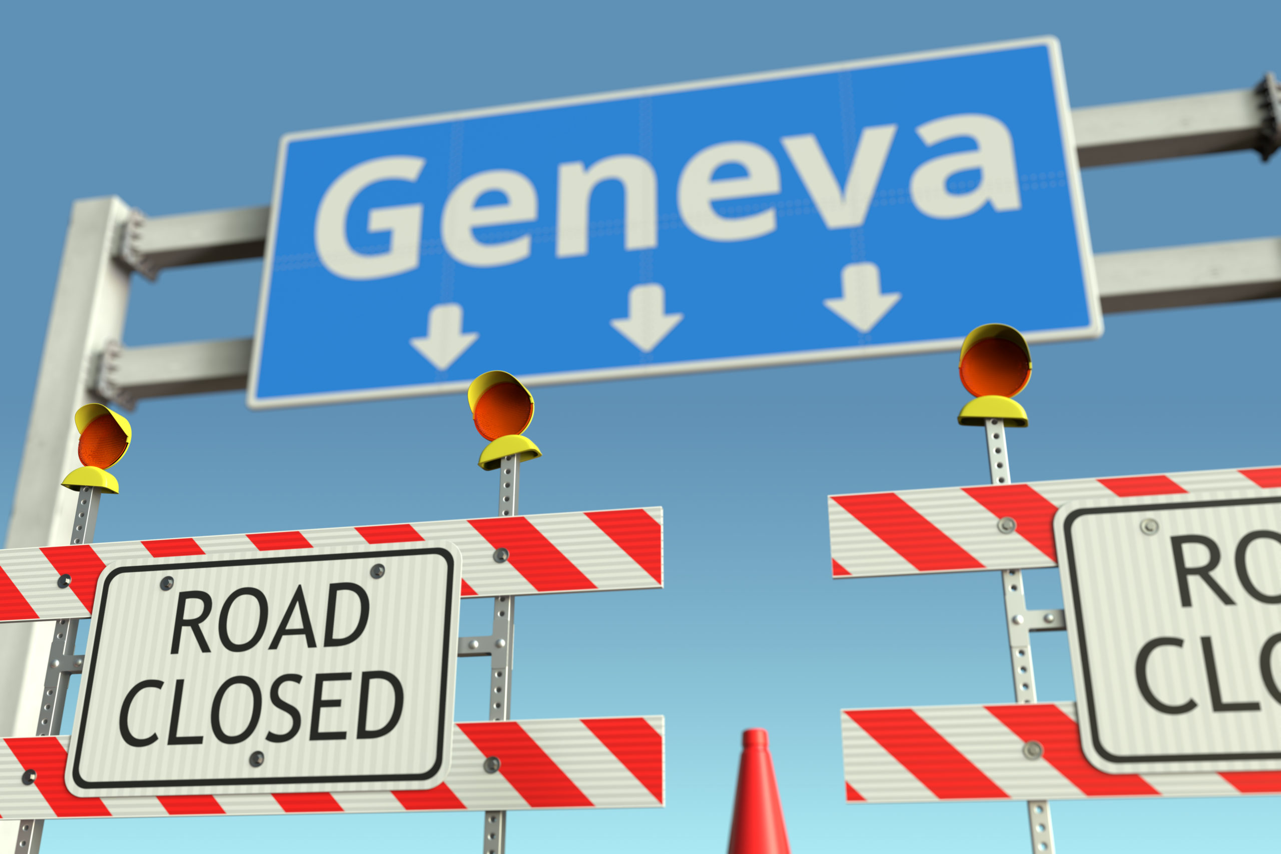 Roadblock near Geneva road sign. Coronavirus disease quarantine or lockdown in Switzerland conceptual