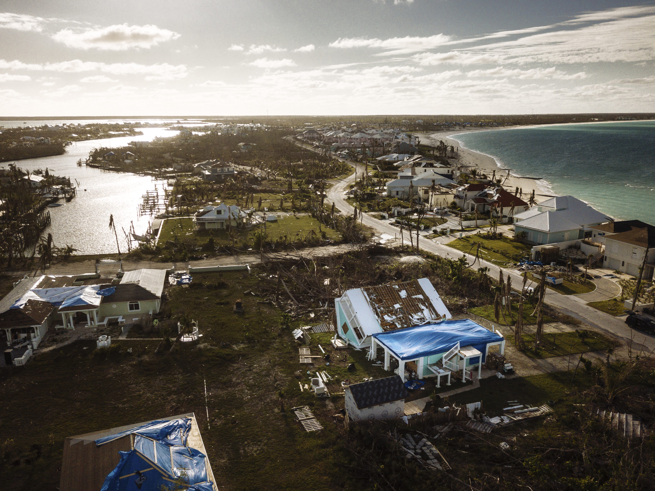 A house can be seen flipped over after being ripped in half in a residential area of Abaco. Two months following the landfall of a powerful category five hurricane in the Bahamas in late September 2019, entire neighbourhoods are still destroyed in affected areas. The storm impacted more than 70,000 people throughout the country, and many have already begun the slow process of rebuilding their lives. ©Muse Mohammed