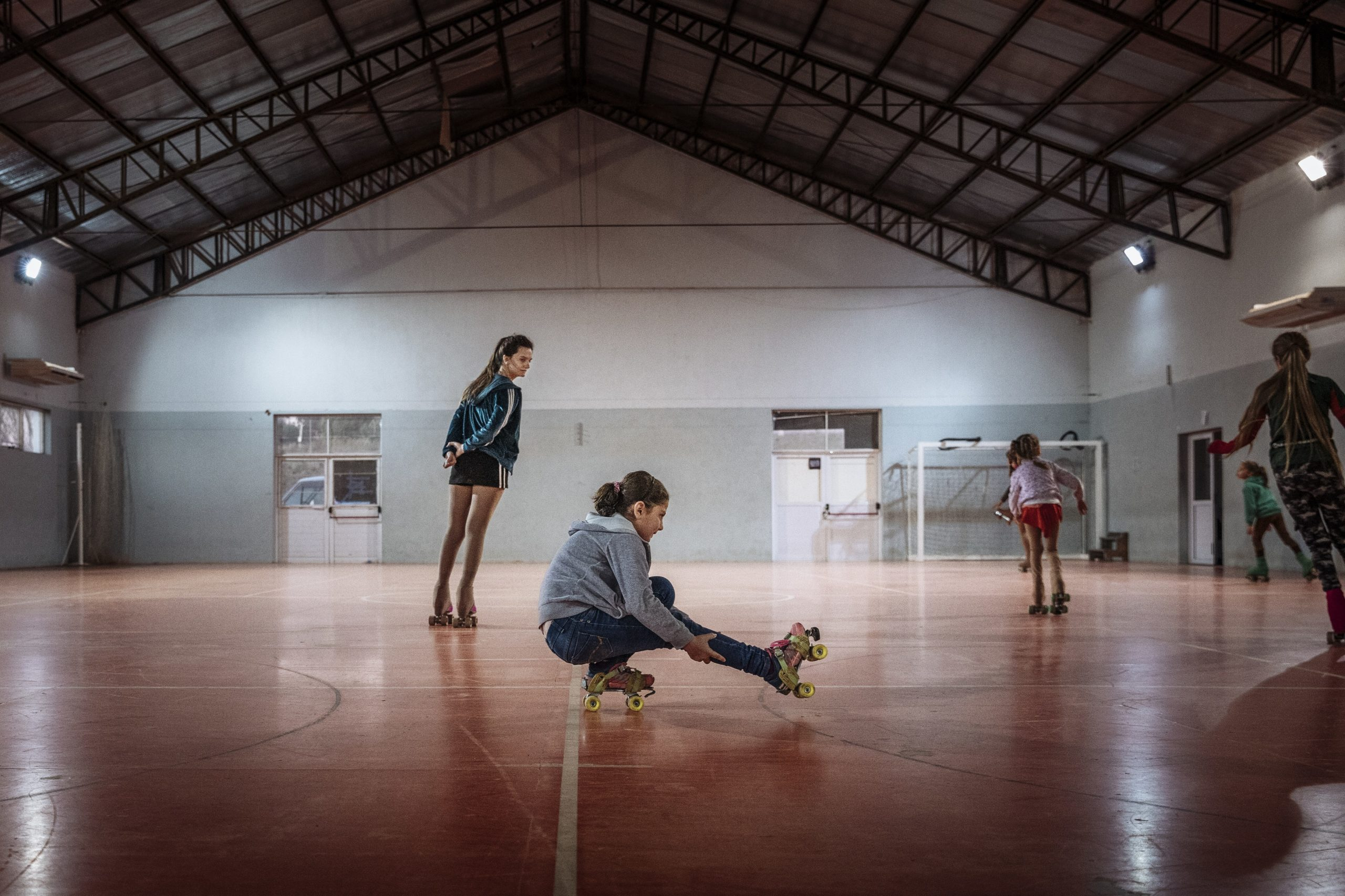 """Revell Alkhouly, an eight-year-old Syrian refugee, has taken up roller-skating since resettling to the small, rural town of Coronel Suárez in Argentina with her parents and two younger brothers. """"The children haven't faced any difficulties since the first day [arriving to Argentina]. To them, this has felt like an adventure or road trip. A child doesn't understand [the whole picture] they see a nice garden, school, playground, as if it were an excursion"""" explain Revell's father Wadeh. Revell and her family is among the hundreds of Syria refugees that have been resettled to Argentina through the help of IOM and partners. ©Muse Mohammed"""