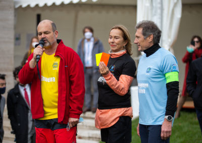 Olga Algayerova, Executive Secretary of UNECE, referee of the game shows the yellow and red cards to the captains of the teams, Sami Kanaan, Mayor of Geneva and Walter Stevens, Ambassador, European Union.