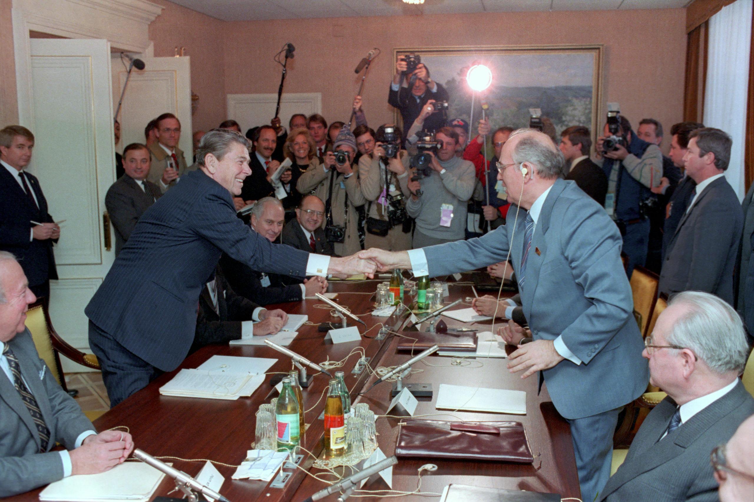 Handshake, a memory of pre-COVID diplomacy. President Ronald Reagan at a Plenary Meeting with Soviet General Secretary Gorbachev at The Soviet Mission During The Geneva Summit, November 1985.