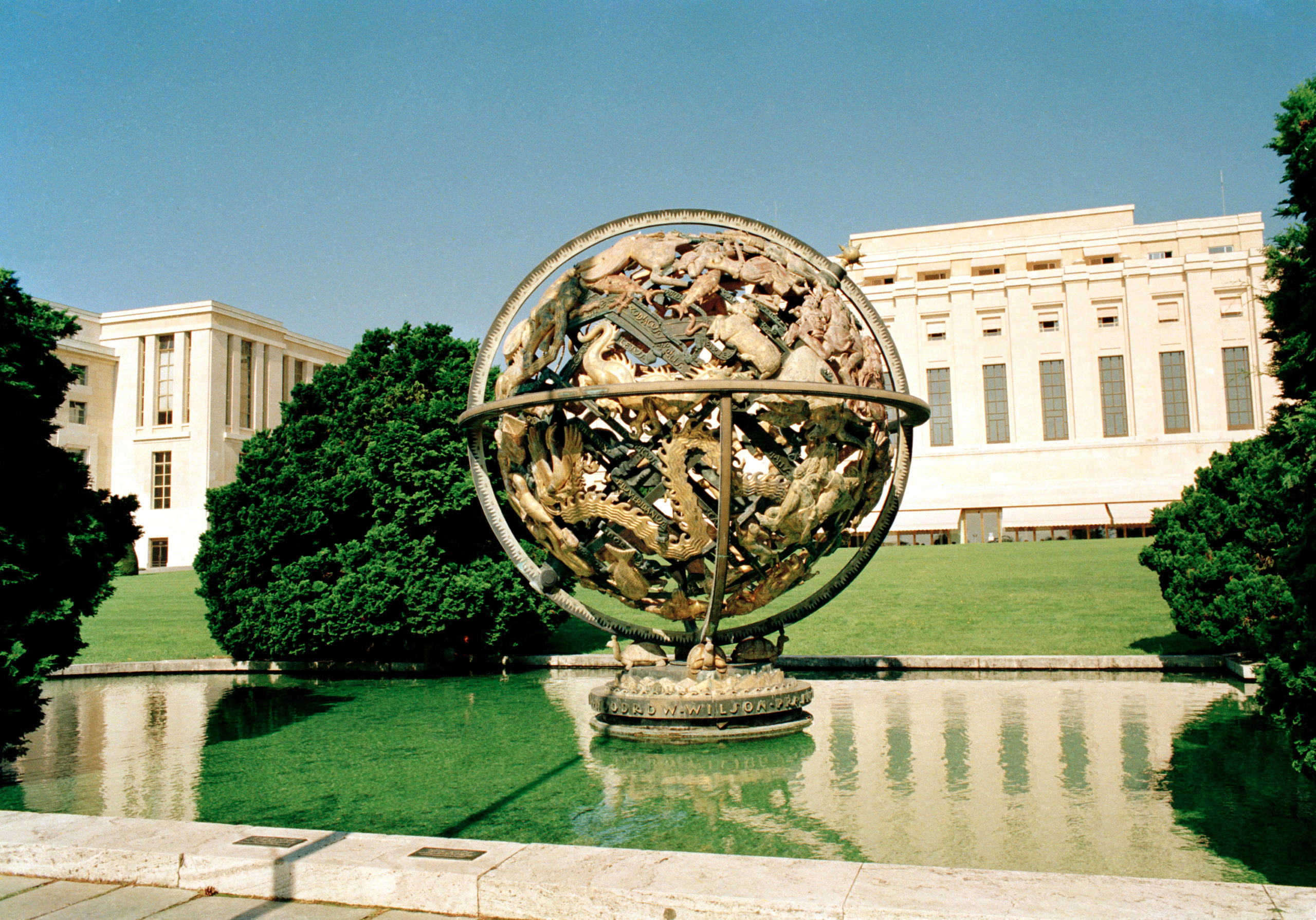 A view of the Palais des Nations with the Manship Sphere in the foreground. The Sphere was designed by Paul Manship, an American sculptor and donated to the League of Nations by the Woodrow Wilson Foundation. It is made of bronze and represents the signs of the Zodiac. © UN PHOTO/P. KLEE