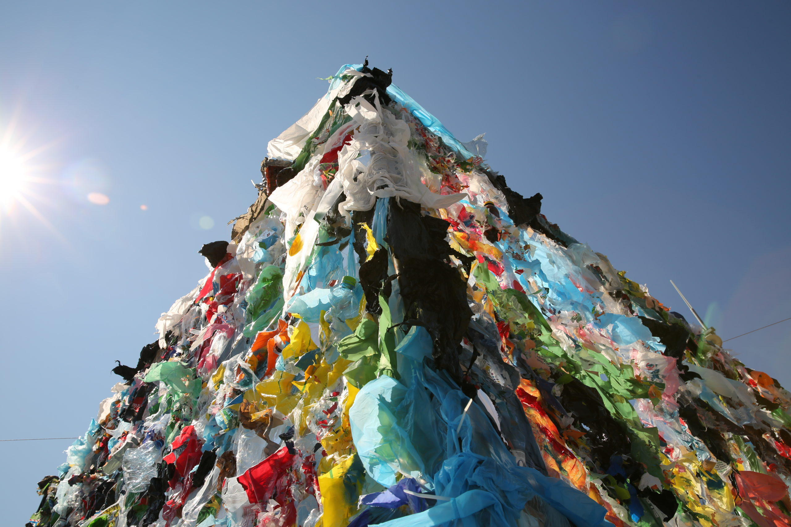 """The M-Cube was a plastic """"sculpture"""" installation which was placed in the Place des Nations in September 2018 to raise awareness of plastic waste, on the margins of the Basel Convention meeting which first """"decided"""" plastic amendments should be formulated and discussed."""